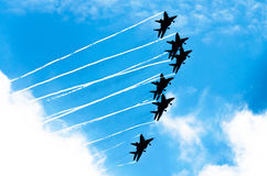 Aircraft fighter jets smoke the background of blue sky white clouds.  Royalty Free Stock Photo