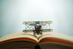 aircraft figther on open book with abstract light studious stude Stock Images