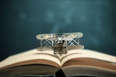 aircraft figther on open book with abstract light studious stude Royalty Free Stock Images