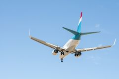 Aircraft on final approach. Southern International Airport of Tenerife stock photo
