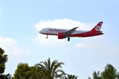 An aircraft on final approach to Alicante airport - Low Flying Airberlin Passenger Plane Royalty Free Stock Photography