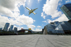 Aircraft flew over the city Royalty Free Stock Image