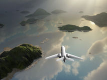 Aircraft flies over a islands Royalty Free Stock Photos