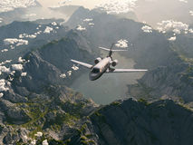 Aircraft flies over a mountains Stock Image