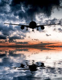 Aircraft flies over the ocean Stock Image