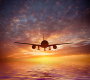 Aircraft flies over the ocean Stock Images
