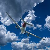 Aircraft in flight with cumulus cloud in blue sky. Australia. An artistic skyscape view of a commercial passenger jet aircraft flying in a vibrant blue sky royalty free stock photo