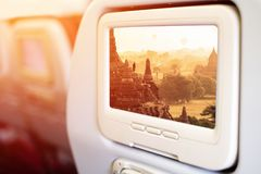 Aircraft In flight entertainment seat-back TV screens. Showing a picture of Sam Pan Boak, the Grand Canyon of Thailand and the biggest rock reef in the Mae Stock Image