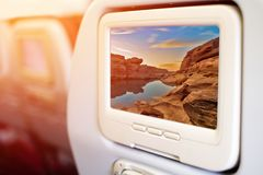 Aircraft In flight entertainment seat-back TV screens. Showing a picture of Sam Pan Boak, the Grand Canyon of Thailand and the biggest rock reef in the Mae Royalty Free Stock Images