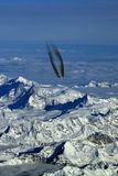 Aircraft in flight over the mountains Stock Image