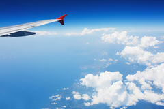 Aircraft flying above the clouds Royalty Free Stock Photography