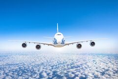 Free Aircraft Flying At Flight Level High In The Sky Above The Clouds And Blue Sky. View Directly In Front, Exactly Stock Photo - 177636380