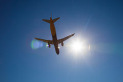 Aircraft flying. In a blue sky Royalty Free Stock Photo