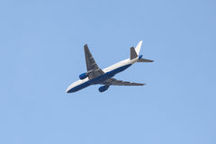 Aircraft flying in blue sky Royalty Free Stock Photo