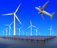 Aircraft is flying in eco power of wind turbines and solar panel Royalty Free Stock Images