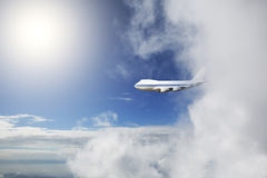 Aircraft flying out cloud Stock Photography