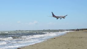 Aircraft flying over beach. Airplane arrival. Hijacked plane crash. Terrorism