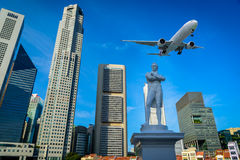 Aircraft flying over the modern city buildings. In Singapore Royalty Free Stock Photos
