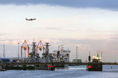 Aircraft flying over the port of Dublin - Ireland Stock Photo