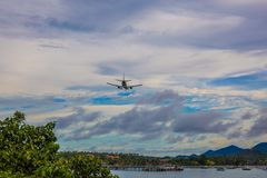 Aircraft flying over the sea. Aircraft flying over the sea at Samui, Thailand Royalty Free Stock Image