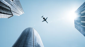 Aircraft flying over skyscrapers Stock Images