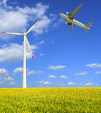 Aircraft is flying in the rice farms Modern wind turbines Stock Images