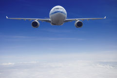 Aircraft flying in sky Stock Photos