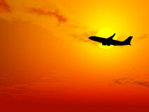 Aircraft flying at sunset Royalty Free Stock Photos