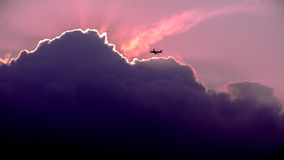Aircraft flying at sunset Royalty Free Stock Image