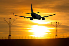 Aircraft flying at sunset. Royalty Free Stock Photography