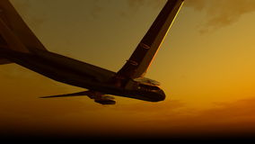 Aircraft flying into sunset stock footage