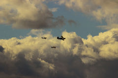 Aircraft flying under a storm cloud Stock Images