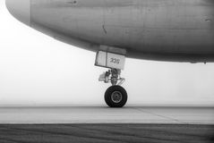 Aircraft on foggy runway royalty free stock image