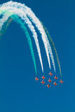 Aircraft formation performing in an airshow. The suryakiran formation flying squadron performs at the Bangalore Aero India 2011 airshow, leaving a trail of stock photography