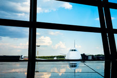 Aircraft framed by airport windows Royalty Free Stock Photography