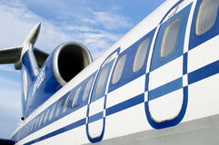 Aircraft fuselage and blue sky Stock Image
