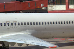 Aircraft by gate number 13. Passenger aircraft outside unlucky gate number 13 or thirteen Stock Photo
