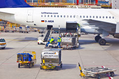 Aircraft gets loaded at Frankfurt International Airport Royalty Free Stock Photography