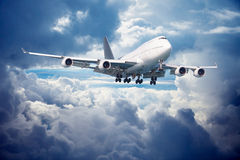 Aircraft is going for landing. Against cloudy sky Royalty Free Stock Photography