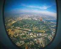 Aircraft illuminator window view, Bangkok Stock Images