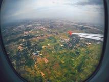 Aircraft illuminator window view, Bangkok Stock Photo