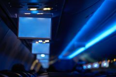 Aircraft indoor tv screens in a row Stock Image