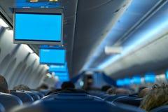 Aircraft indoor tv screens in a row Stock Photos