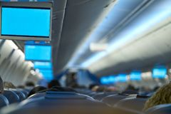 Aircraft indoor tv screens in a row Stock Photo