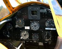 Aircraft Instrument Panel. Cockpit instrument panel located at the pilots position of an antique biplane, circa 1929-30 stock photography