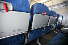 Aircraft interior. Wide view of seats in economy class of aircraft stock image