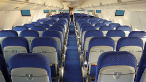 Aircraft interior. Passenger seats interior of salon of the Boeing 737 Stock Photography