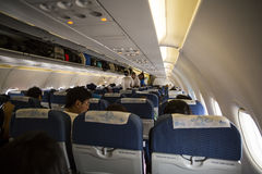 Aircraft interior with passengers Stock Image