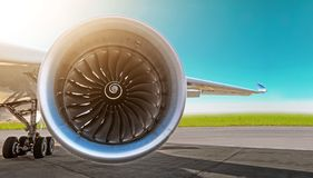 Aircraft jet engine close-up, airplane wing and chassis of landing gear wheel parked at the airport on a sky background, panorama. Aircraft jet engine close-up royalty free stock photo