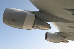 Aircraft jet engines. Closeup of jet aircraft engines attached to the wing of a large passenger jetliner royalty free stock photography
